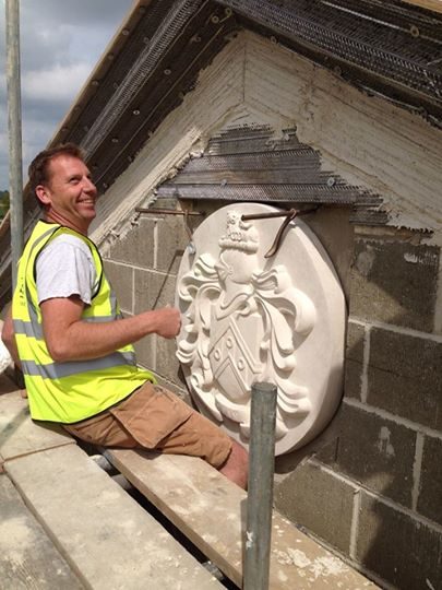 Decorative shield being fixed in place