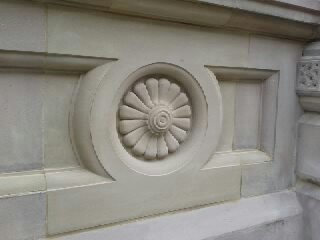 Stone rose fixed in the wall at Barclays Bank