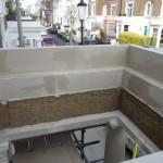 Upper construction on portico