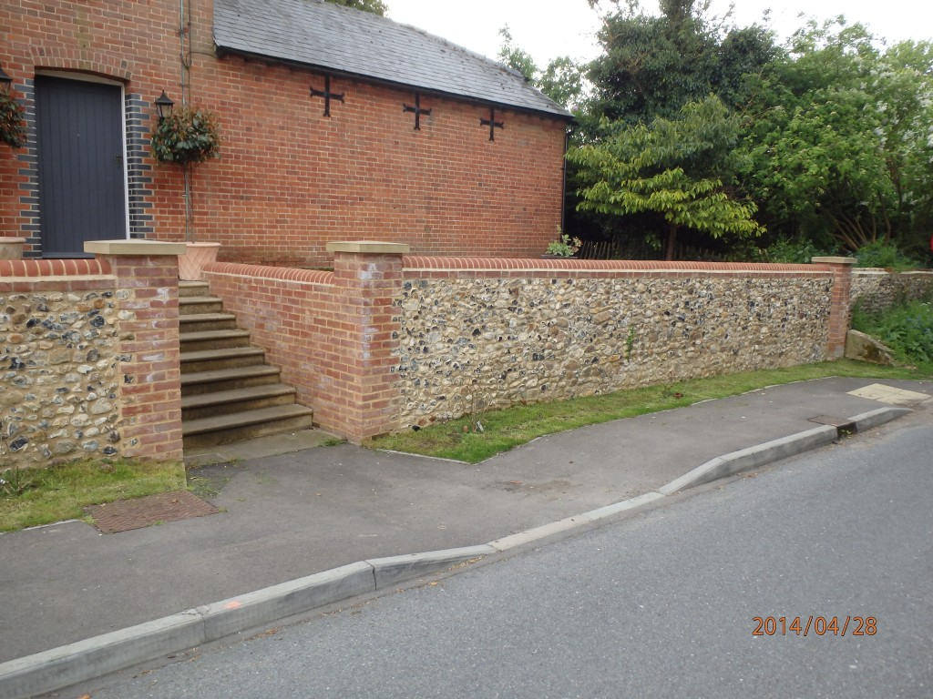 Flint Wall rebuilt and new sand stone steps